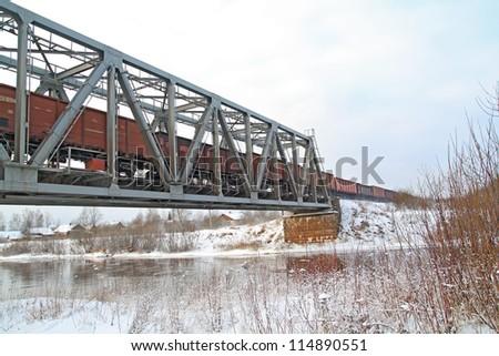 freight train on railway bridge - stock photo