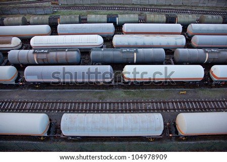 Freight train transports tanks with oil and fuel - stock photo