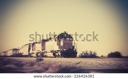 Freight train traveling through Arizona desert - stock photo