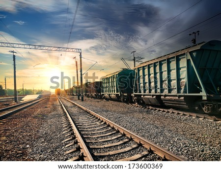 Freight train wagons at the station in the evening - stock photo