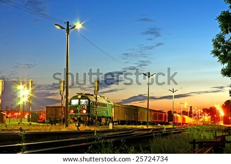 Freight train waiting at station during the evening