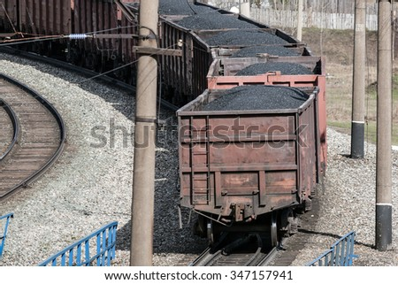 freight train with wagons full of coal - stock photo