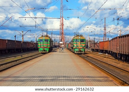 Freight trains passing station - stock photo