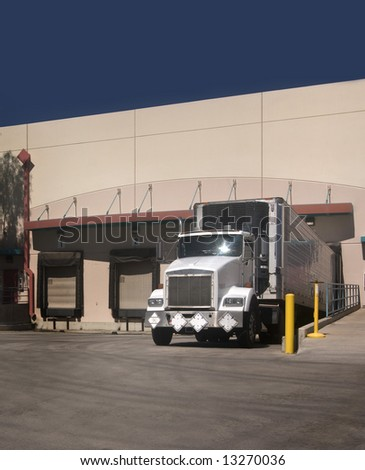 Freight Truck at loading bay with copy space - stock photo