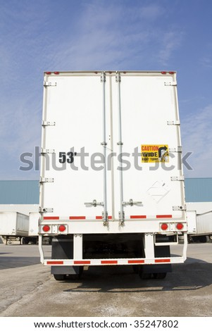 Freight Truck in yard from behind - stock photo