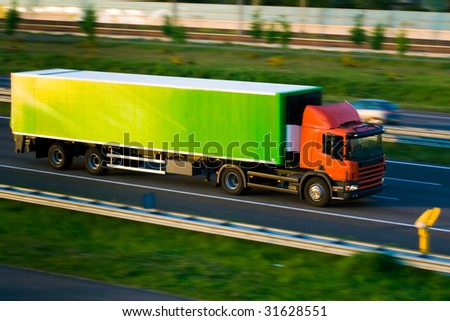 Freight truck on motorway. Motion blur - stock photo