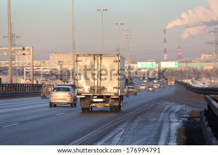 Freight truck on the city highway - stock photo