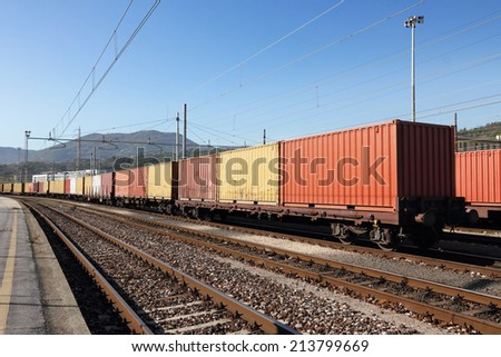 freight wagons cargo containers in parked on railway - stock photo