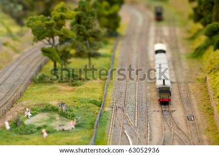 freight wagons on a miniature train set with shallow d.o.f - stock photo