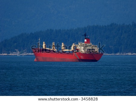 Freighter at anchor in Vancouver harbour - stock photo