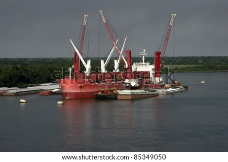 Freighter ship loading sugar on the mississippi river - stock photo