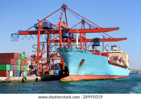 Freighter ship under loading in docks - stock photo