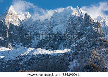 French alps mountain peaks covered with fresh snow. Winter landscape nature scene on beautiful sunny winter day. - stock photo