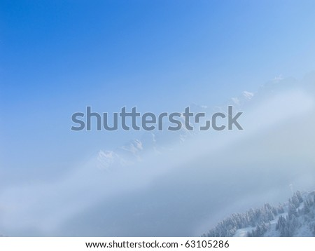 French alps seen rising above the mountain mist. les contamines. - stock photo