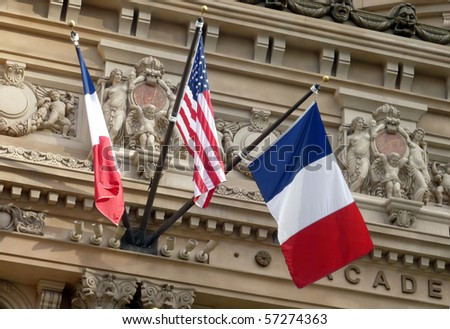 French and American Flags on Building Facade - stock photo
