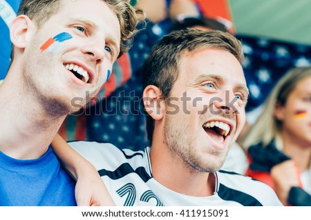 French and German fans at the stadium together - stock photo