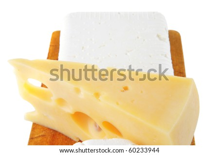 french and greek cheeses on wooden board