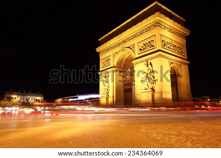 French Arch of Triumph roundabout at night  - stock photo