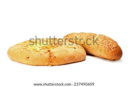 French baguette and Round flat Bread with cheese isolated on white - stock photo