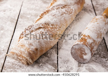 French baguette on the wooden backgroung