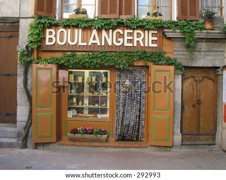 French bakery found in a litte village. Products in the window are softed to hide trademarks. - stock photo
