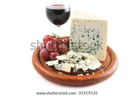french blue cheese with sweet red wine - stock photo