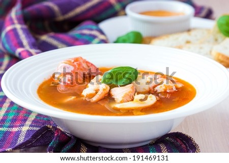 French Bouillabaisse fish soup with seafood, salmon fillet, shrimp, rich taste, tasty dinner - stock photo