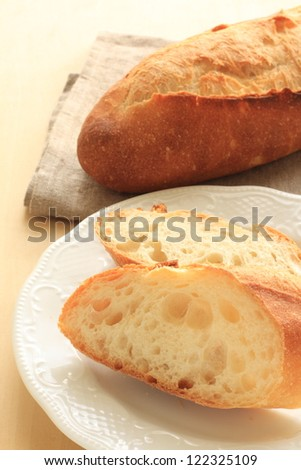 French bread, baguette sliced on white dish
