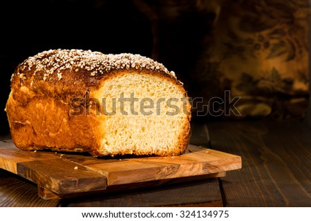 French Brioche - french sweet brioche bread on tray on the black background - stock photo