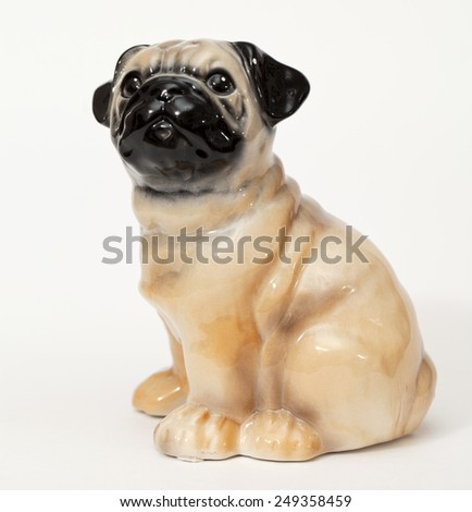 French Bulldog. Ceramic figurine, dog breed isolated on white - stock photo