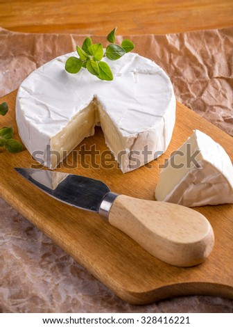 French camembert pieces served on wooden cutting board