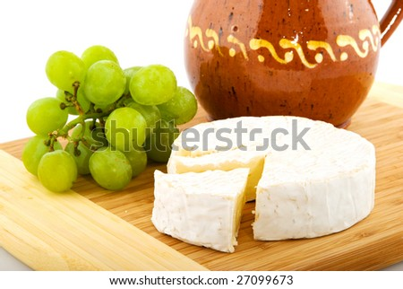 French camembert with white grapes and wine carafe
