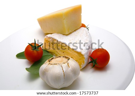 french cheese and vegetables on white plate - stock photo