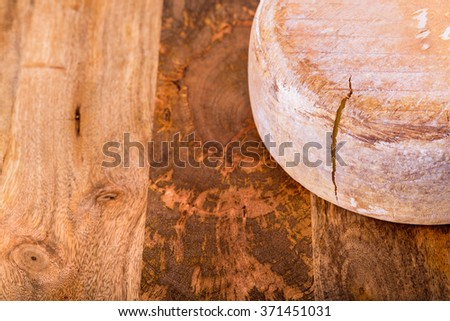 french cheese - big ossau-iraty - on wooden table