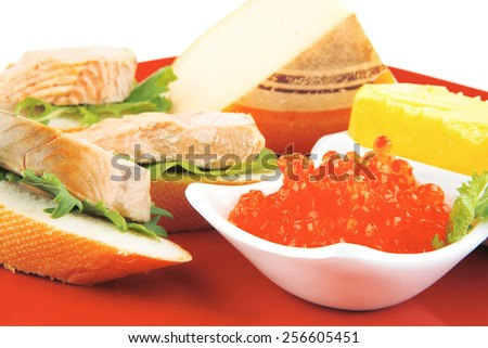 french cheese,caviar, and fried salmon sandwich over red dish - stock photo