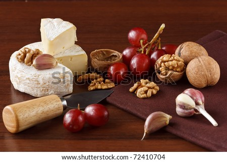 French cheese, nuts, red grapes and garlic.