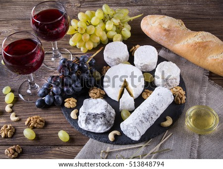 French cheese plate with Camembert Valencay Crottin de Chavignol Sainte-maure de & French Cheese Plate Camembert Valencay Crottin Stock Photo (Royalty ...