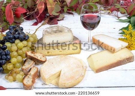 french cheese platter with wine and grapes