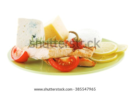 french cheeses and salmon with vegetables on green plate - stock photo