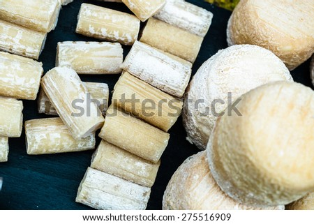French chesse production in a market in Paris - stock photo