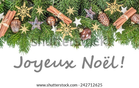 french Christmas card  with Christmas baubles, fir branches, stars and text Merry Christmas/Merry Christmas/french - stock photo