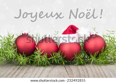 french Christmas card with red christmas balls/merry christmas/french - stock photo