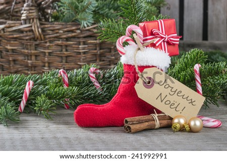 french christmas card with red sock, gifts, Candy canes and text merry christmas/merry christmas/france - stock photo