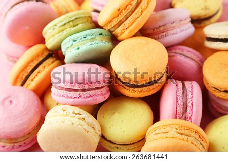 French colorful macarons on pink background - stock photo