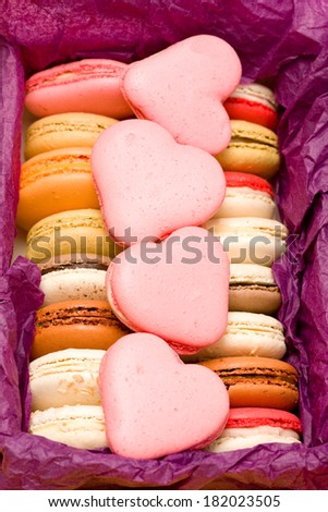 French colorful macarons with hearts in box  - stock photo