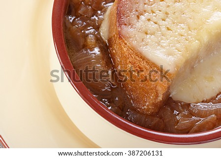 French cuisine. Onion soup served in a tureen - stock photo