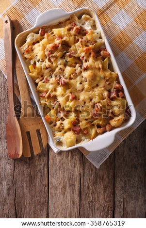 French cuisine: tartiflette potatoes with bacon and cheese in baking dish. Vertical top view - stock photo