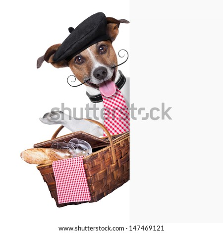 french dog with  Picnic basket behind placard - stock photo