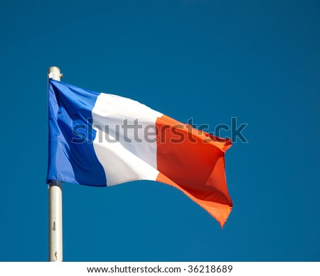 French flag against blue sky - stock photo