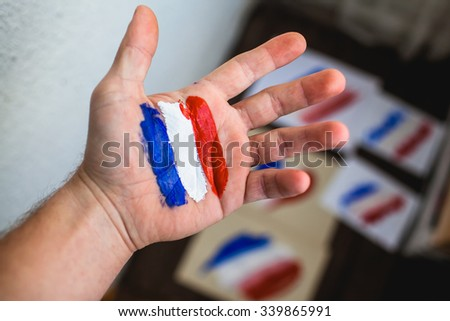 French flag in hand